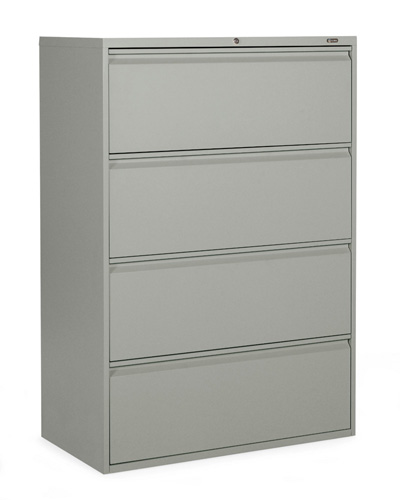 A 4 drawer file cabinet stacked vertically against a wall, in grey.
