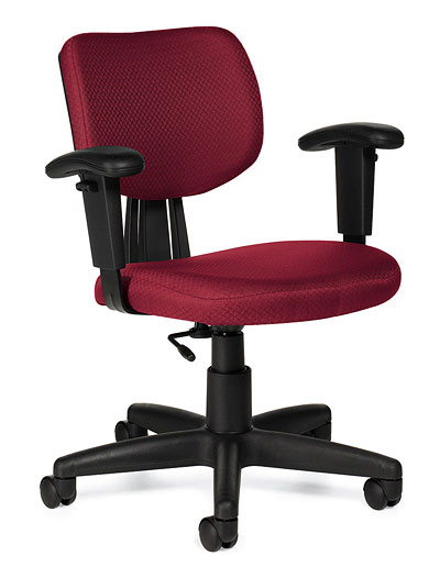 A red tami chair, upholstered with black arm rests and tilted at a 45-degree angle.