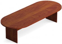 A brown 12 foot conference room table with rounded edges with two thin and wide feet supporting it at either end.