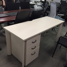 A white-grainy used desk from Steelcase with three drawers on the left-hand underside.